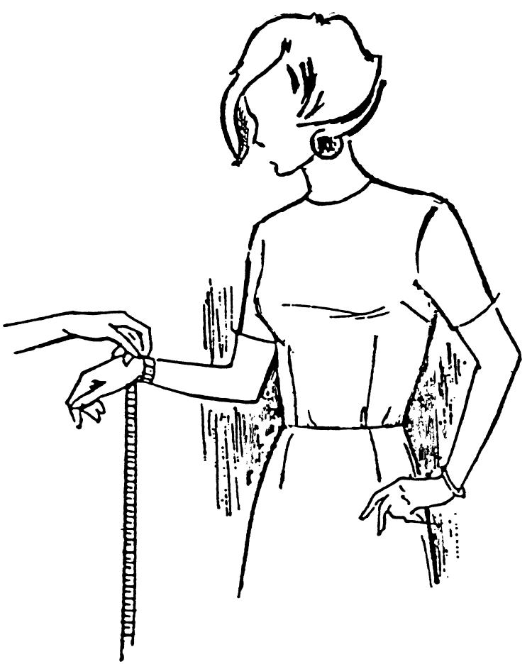 Eine DOB Zeichnung zeigt das Maßnehmen von Handgelenkumfang.